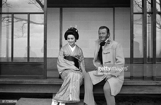 Eiko Ando and John Wayne take a break from production in Kyoto during the making of the film The Barbarian and the Geisha Wayne portrayed Townsend...