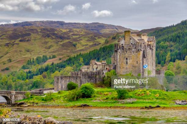 eilean donan castle, scotland - scotland flag stock photos and pictures