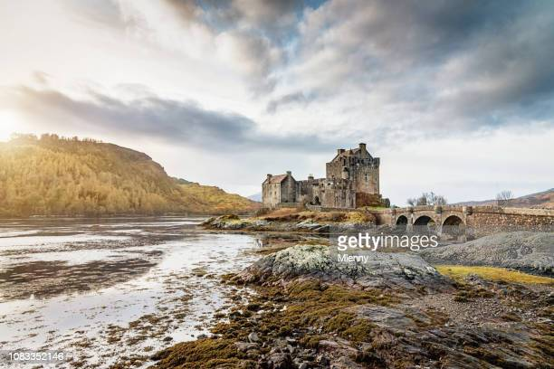 eilean donan castle sunset scotland - castle stock pictures, royalty-free photos & images
