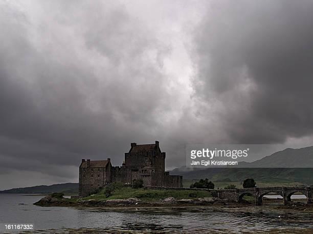Eilean Donan Castle under a dark sky on an island in Loch Duich in the Highlands.