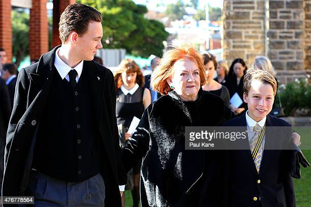 Eileen Bond the former wife of the late Alan Bond walks with family members into the funeral service at St Patrick's Basilica on June 12 2015 in...