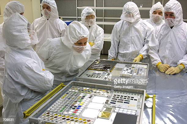 Eileen Collins Mission Commander for NASA shuttle flight STS114 inspects one of the Passive Experiment Containers in a clean room at the NASA Langley...