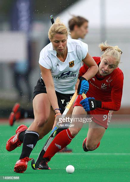 Eileen Hoffmann of Germany gets past the efforts of Natalie Seymour of Great Britian during the Investec London Cup match between Germany and Great...