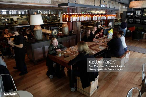 Eileen Kornblum of Menlo Park and Rebecca Friend of Palo Alto enjoy the Calafia Cafe along with other diners in Palo Alto, Calif. On Monday May 24,...