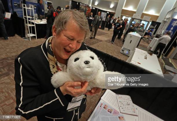 Eileen Manning CEO of The Event Group held a Paro a therapeutic seallike robot at the Robotics Alley Conference and Expo at the St Paul River Center...