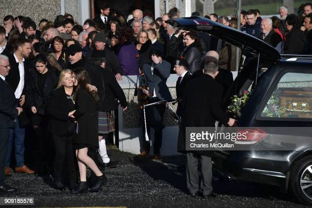 Eileen O'Riordan mother to the late Dolores O'Riordan hugs Molly O'Riordan daughter of Dolores O'Riordan outside St Ailbe's Church Ballybricken on...