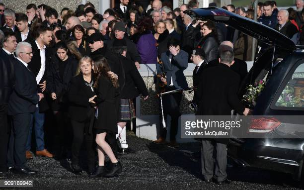 Eileen O'Riordan mother to the late Dolores O'Riordan hugs the daughter of Dolores O'Riordan outside St Ailbe's Church Ballybricken on January 23...
