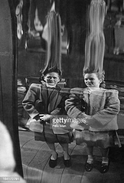 Eileen Rock and Eileen Chaisty see themselves afresh during a visit to the hall of mirrors at Belle Vue the popular amusement park in Manchester May...