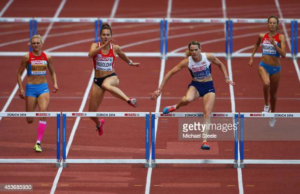 Eilidh Child of Great Britain and Northern Ireland and of Denisa Rosolova of the Czech Republic clear the final hurdle in the Women's 400 metres...