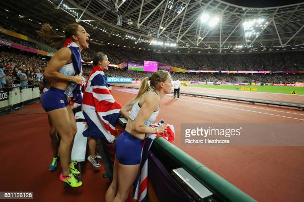 Eilidh Doyle Emily Diamond Zoey Clark and Laviai Nielsen of Great Britain Women's 4x400 Metres Relay team cheer on their mens counterparts in their...