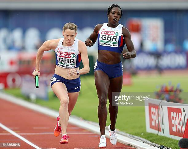 Eilidh Doyle of Great Britain takes the baton from team mate Anyika Onuora during the final of the womens 4x400m relay on day five of The 23rd...