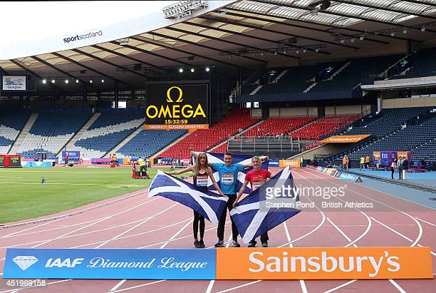 R Eilish McColgan Chris O'Hare and Eilidh Child of Scotland pose during a photo call ahead of the Sainsbury's Glasgow Grand Prix on July 10 2014 at...