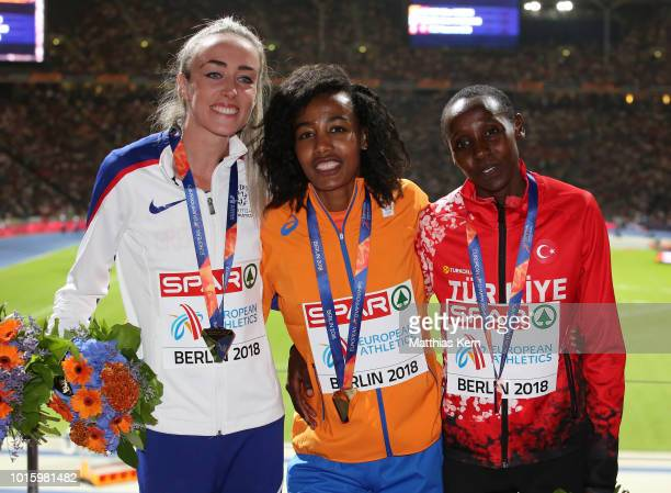 Eilish McColgan of the Great Britain silver Sifan Hassan of the Netherlands gold and Yasemin Can of Turkey bronze pose with their medals for the...