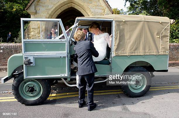 Eimear Montgomerie is helped into a canvas roofed Land Rover as she leaves St Nicholas Church after her wedding to Nick Cook on September 20 2009 in...