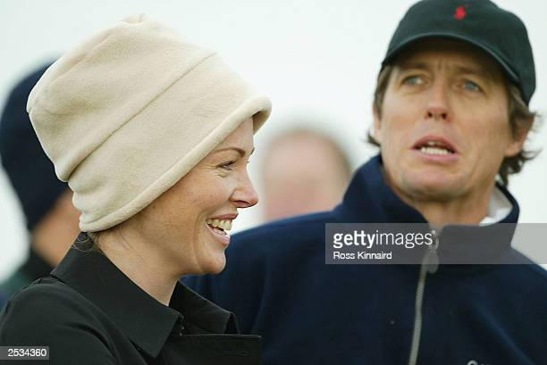 Eimear Montgomerie wife of Colin chats with actor Hugh Grant during the first round of the Dunhill Links Championship on September 25 2003 at...