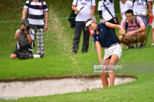 Eimi Koga of the United States hits out from a bunker on the 5th hole during the final round of the Earth Mondamin Cup at the Camellia Hills Country...