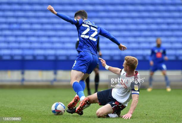 Eóin Doyle of Bolton Wanderers tussles with Ed Francis of Harrogate Town during the Sky Bet League 2 match between Bolton Wanderers and Harrogate...