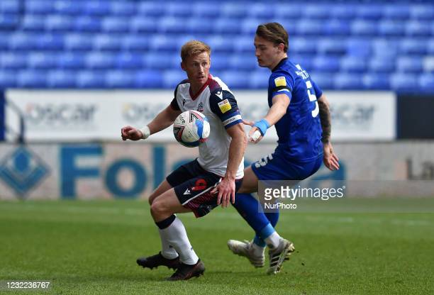 Eóin Doyle of Bolton Wanderers tussles with Will Smith of Harrogate Town during the Sky Bet League 2 match between Bolton Wanderers and Harrogate...