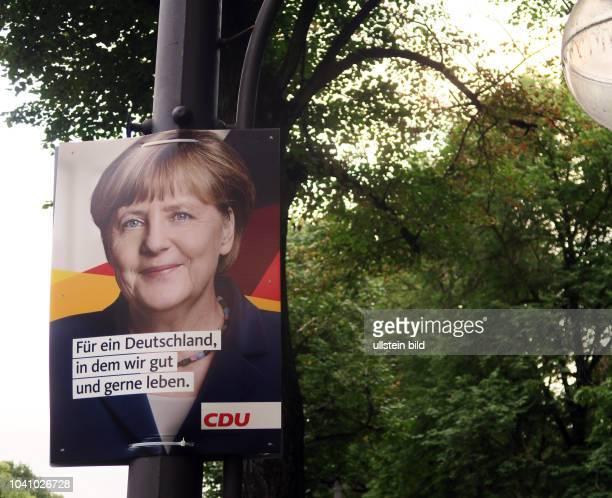 Ein Wahlplakat der CDU mit dem Porträt von Angela Merkel aufgenommen in Berlin Die Bundestagswahl findet statt