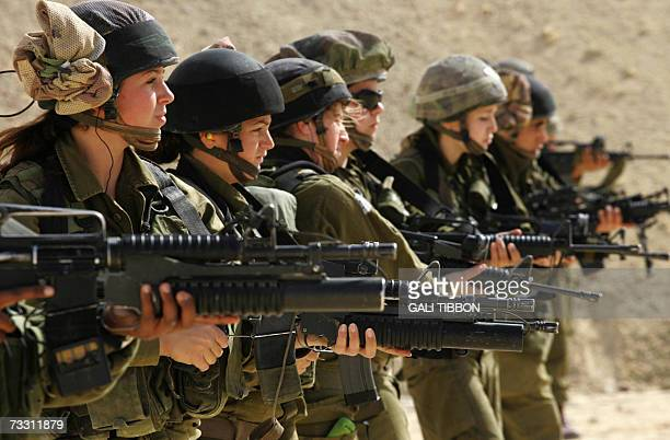 Female Israeli combat soldiers of the Caracal light infantry Battalion hold up their M16 rifles at a shooting range in Ein Yahav southern Israel 13...