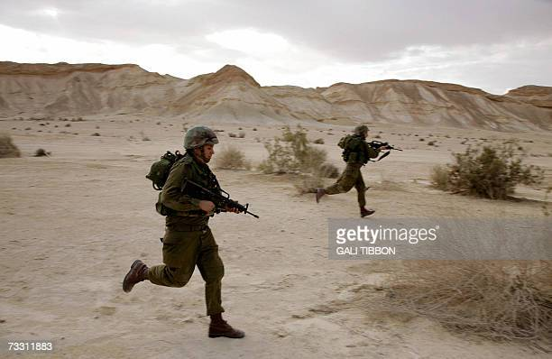 Female Israeli combat soldiers of the Caracal light infantry Battalion storm targets during a training session in Ein Yahav southern Israel 13...
