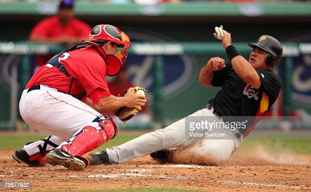 Einar Diaz of the Pittsburgh Pirates is tag out at the plate by catcher Kevin Cash of the Boston Red Sox during a Spring Training game on March 14...