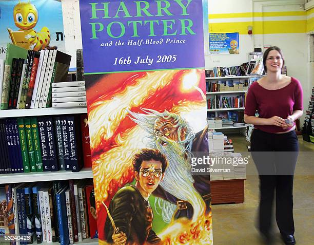 Einat Ofrat a dedicated Harry Potter fan from the Israeli town of Haifa passes a poster for J K Rowling's new book Harry Potter And The HalfBlood...