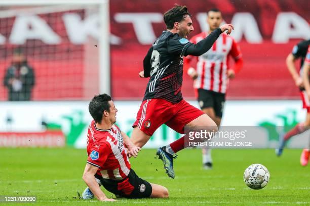 Eindhoven Dutch defender Nick Viergever fights for the ball against Feyenoord's Dutch midfielder Orkun Kokcu during the Dutch Eredivisie match...