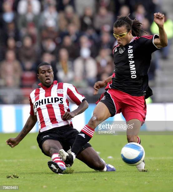 Ajax Amsterdam's Surinamese midfielder Edgar Davids fights for the ball with Edison Mendes 18 March 2007 during their Dutch Championships match in...