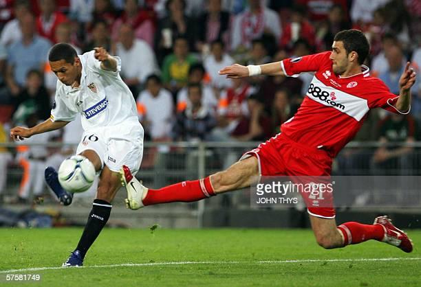 Eindhoven, NETHERLANDS: Sevilla's Spanish forward Jesus Navas Adriano Correia vies with Middlesbrough 's British defender Stuart Parnaby during the...