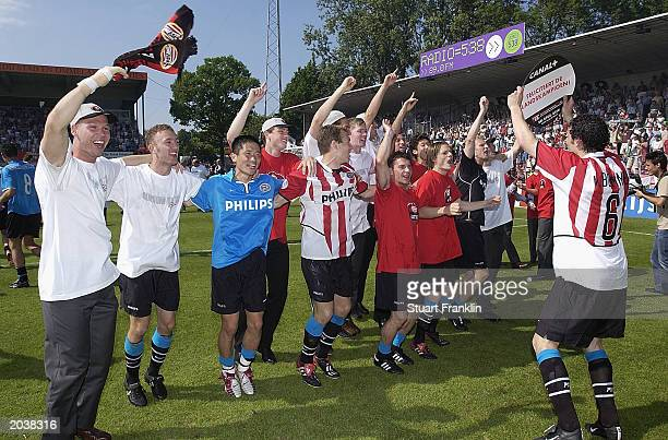 Eindhoven players celebrate winning the Dutch league after their match against FC Groningen at the Ooster Park Stadium May 29 2003 in Groningen...