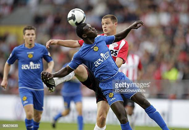 Eindhoven 's Danhy Koevermans duels with Roda JC Kerkrade's Eric Addo during their Dutch first league match on September 12, 2009 in Eindhoven. ANP...