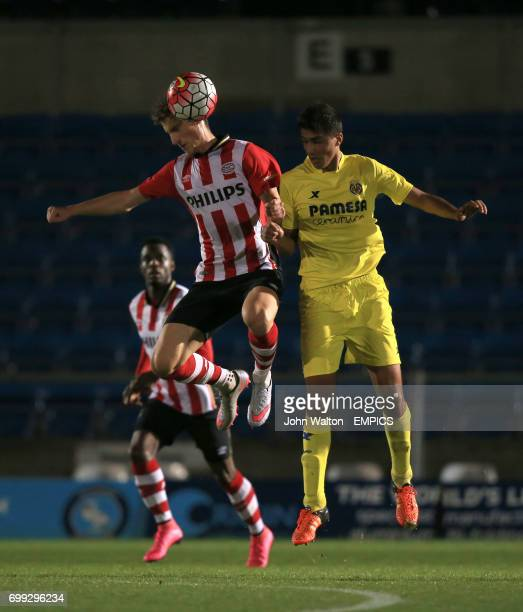 PSV Eindhoven's Boris Cmiljanic battles for possession of the ball in the air with Villarreal's Rodrigo Hernandez