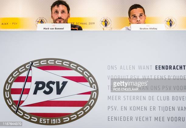 PSV Eindhoven's coach Mark van Bommel and captain Ibrahim Afellay attend a press conference in Eindhoven the Netherlands on July 25 ahead of their...