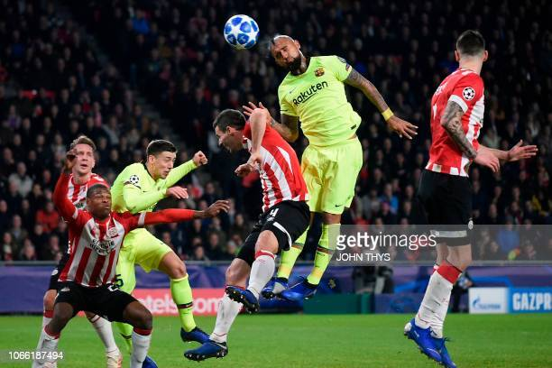 Eindhoven's defender Nick Viergever vies with Barcelona's Chilean midfielder Arturo Vidal during the UEFA Champions League football match between PSV...