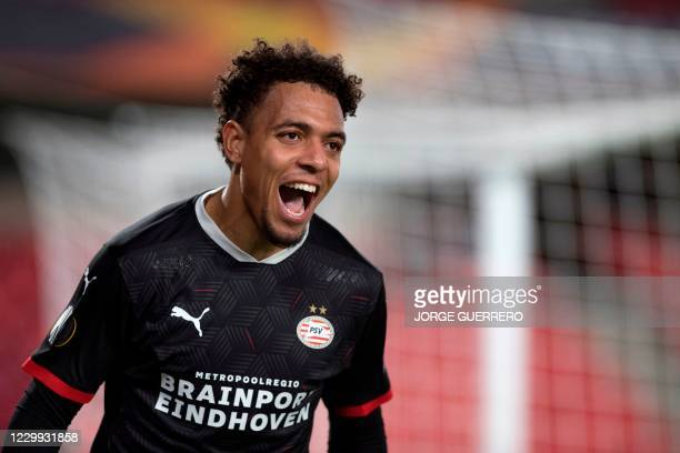 Eindhoven's Dutch forward Donyell Malen celebrates after scoring a goal during the UEFA Europa League group E football match between Granada and PSV...