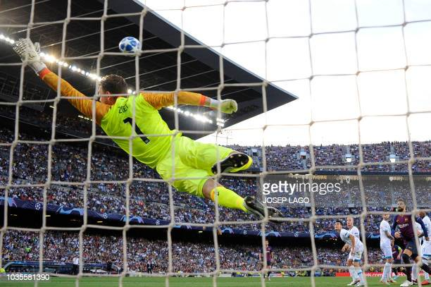 PSV Eindhoven's Dutch goalkeeper Jeroen Zoet faisl to stop the ball kicked by Barcelona's Argentinian forward Lionel Messi during the UEFA Champions'...