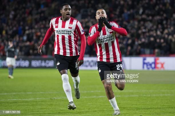 PSV Eindhoven's Dutch midfielder Mohammed Amine Ihattaren celebrates past PSV Eindhoven's Dutch midfielder Pablo Rosario after scoring during the...