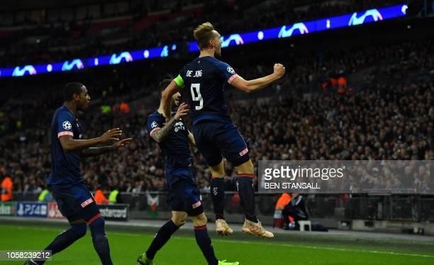 Eindhoven's Dutch striker Luuk De Jong celebrates scoring his team's first goal during the UEFA Champions League group B football match between...
