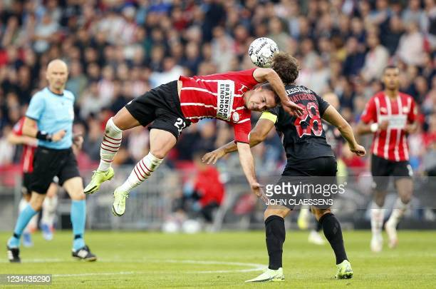Eindhoven's German Mario Gotze vies for the ball with FC Midtjylland's defender Erik Sviatchenko during the UEFA Champions League - third qualifying...