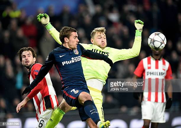 PSV Eindhoven's goalkeeper Jeroen Zoet and Atletico Madrid's French forward Antoine Griezmann challenge for the ball during the UEFA Champions League...