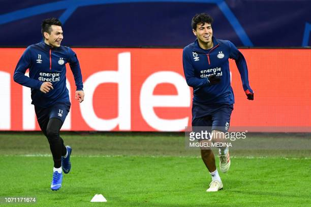 PSV Eindhoven's Mexican forward Hirving Lozano and PSV Eindhoven's Mexican midfielder Erick Gutierrez run during a training session on the eve of the...