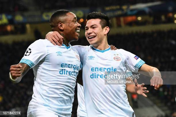 PSV Eindhoven's Mexican forward Hirving Lozano celebrates with PSV Eindhoven's forward Steven Bergwijn after opening the scoring during the UEFA...