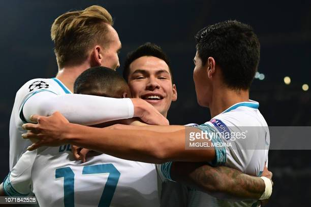 PSV Eindhoven's Mexican forward Hirving Lozano celebrates with teammates after opening the scoring during the UEFA Champions League group B football...
