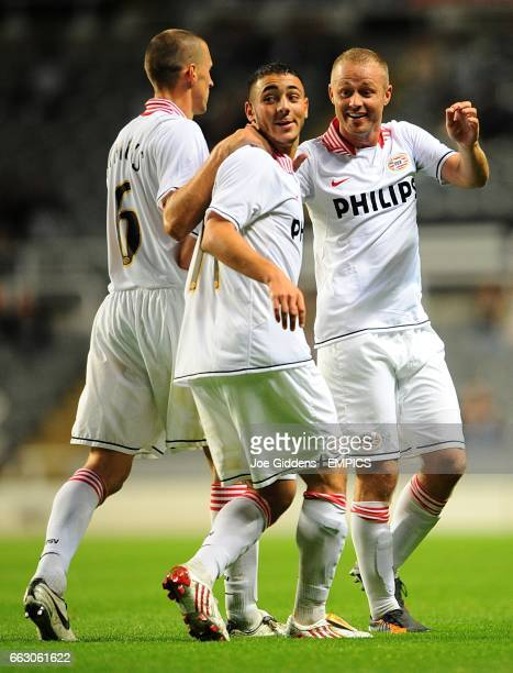 PSV Eindhoven's Nordin Amrabat celebrates with his team mates after scoring the fourth goal of the game