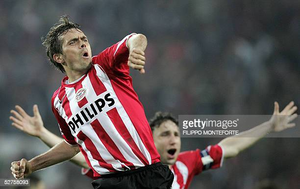 Eindhoven's Philip Cocu jubilates after scoring the second goal against AC Milan during the Champion's league semifinal second leg football match in...