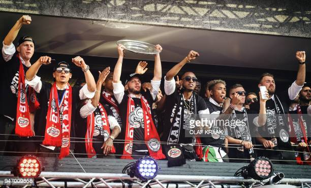 PSV Eindhoven's players celebrate a day after winning winning their 24th Dutch Eredivisie title on April 16 in Eindhoven / AFP PHOTO / ANP / Olaf...