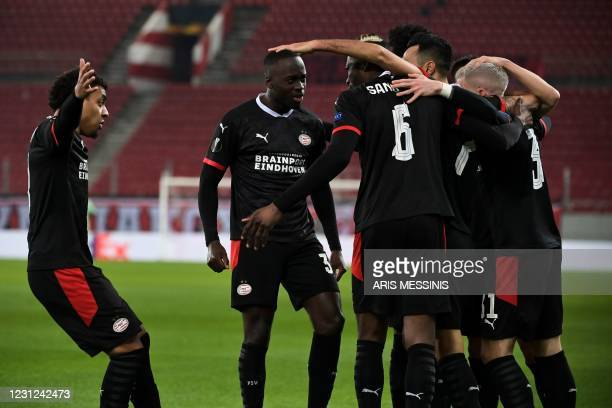 Eindhoven's players celebrate a goal during the UEFA Europa League round of 32 first leg football match between Olympiacos FC and PSV Eindhoven at...