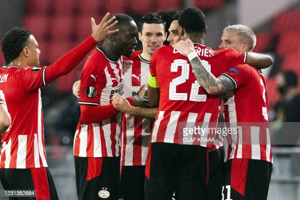 Eindhoven's players celebrate after scoring during the UEFA Europa League round of 32 second-leg football match between PSV Eindhoven and Olympiakos...