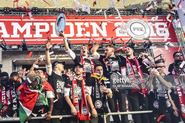 PSV Eindhoven's players celebrate with their supporters a day after winning winning their 24th Dutch Eredivisie title on April 16 in Eindhoven / AFP...